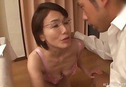 Full-grown Japanese MILF back glasses rides horseshit anent a bra