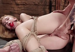 Young Alina West likes it rough and is hogtied and ass banged wide of a Master